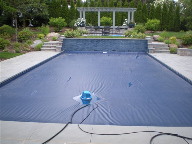 Pool cover pump an essential item for winterizing and protecting your pool cover diycontrols blog for Opening swimming pool after winter